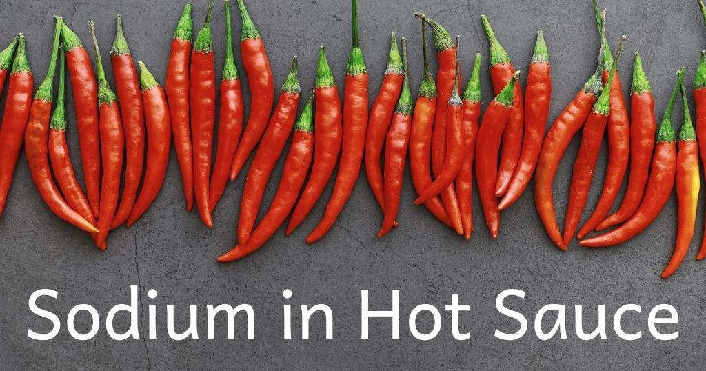 Sodium in hot sauce. Red, dried chili peppers in a row