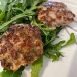 Picture of low sodium sausage patties over greens