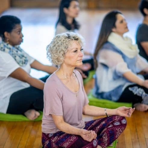 Women practicing meditation together. Meditation can be a wonderful stress reduction technique