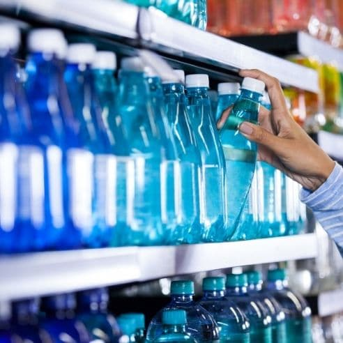 Bottled water on a shelf in a store