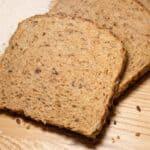 sliced wheat bread on wood cutting board