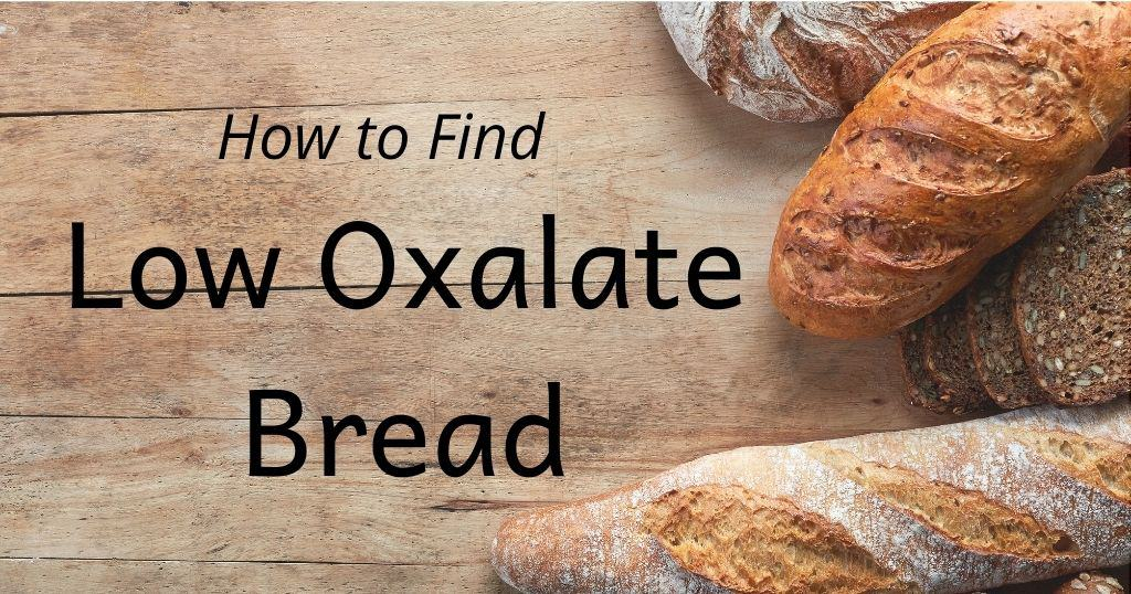 """Artisan bread loaves on wood table with title: How to Find Low Oxalate Bread"""" over top of image"""