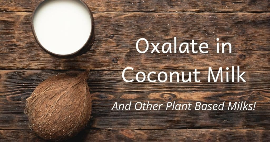 """Title: """"Oxalate in Coconut Milk and other plant based milks"""" across a wooden table with a coconut and glass of coconut milk"""